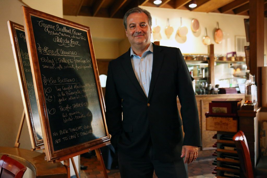 Saint-Emilion owner Bernard Tronche with a blackboard list of specials
