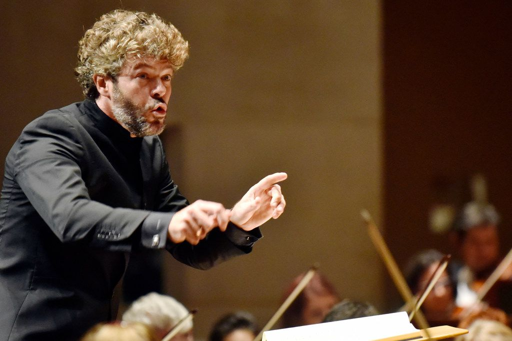 Guest conductor Pablo Heras-Casado conducts the Dallas Symphony Orchestra during a performance of Debussy La Mer (The Sea), Thursday evening.