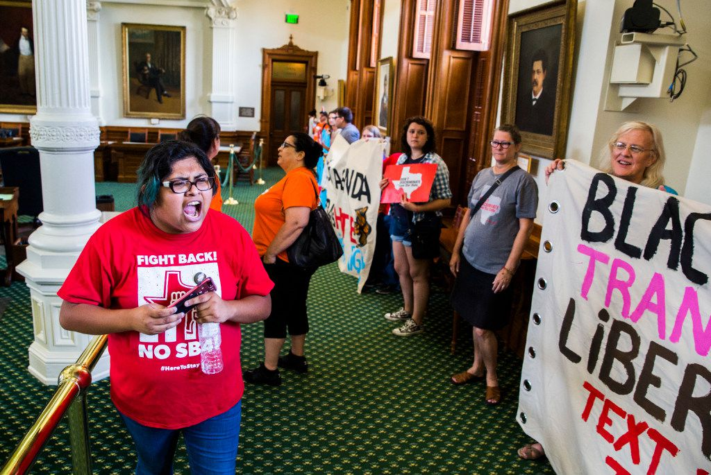 Yunuen Alvarado of Austin leads protesters as they chant on the Senate floor as they wait in line to sign the guestbook of Lt. Gov. Dan Patrick during a One Texas Resistance rally on the first day of a legislative special session on Tuesday, July 18, 2017 at the Texas state capitol in Austin, Texas. Demonstrators were told they could not protest outside Patrick's office, so they each signed his guestbook in the hallway. (Ashley Landis/The Dallas Morning News)