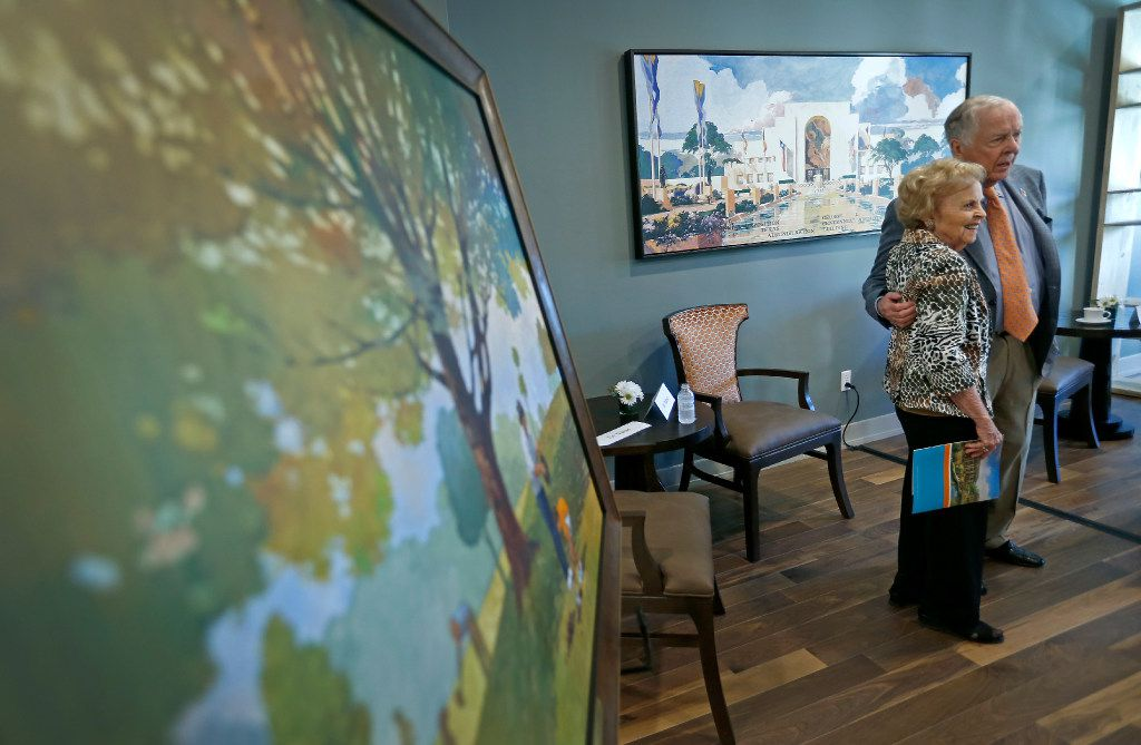 T. Boone Pickens (right) poses for a photograph with Freddie Hodges, whose family donated a painting (pictured in the left) to the T. Boone Pickens Hospice and Palliative Care Center after a dedication ceremony in Dallas, Tuesday, April 18, 2017. (Jae S. Lee/The Dallas Morning News)