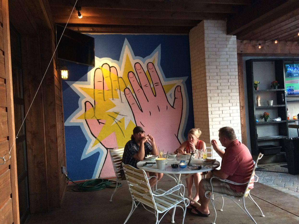 High Fives are abundant at this new spot on Henderson. The bar and restaurant has an indoor-outdoor feel because of a large patio and doors that open the inside space to it.