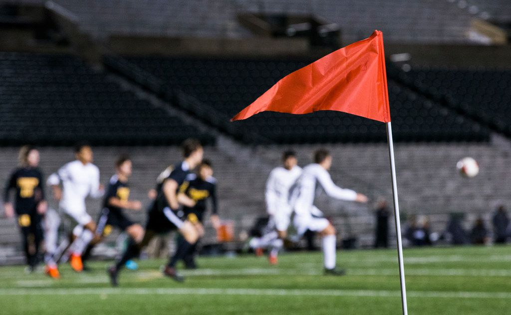 A red sideline flag waves at a corner of the field during a soccer game between Forney High School and Poteet High School on Tuesday, January 30, 2018 at Poteet High School in Mesquite, Texas. The game follows sexual assault allegations and arrests of five Forney soccer players.