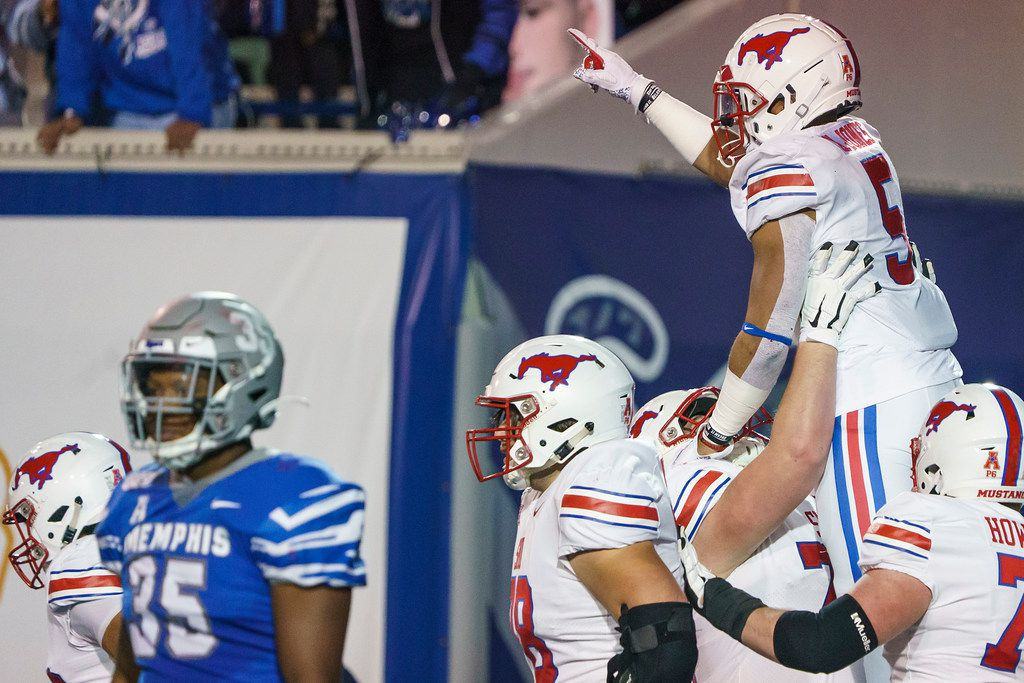 SMU running back Xavier Jones (5) celebrates with offensive lineman Beau Morris (78) after scoring on a touchdown run during the first half of an NCAA football game at Liberty Bowl Memorial Stadium on Saturday, Nov. 2, 2019, in Memphis, Tenn. (Smiley N. Pool/The Dallas Morning News)
