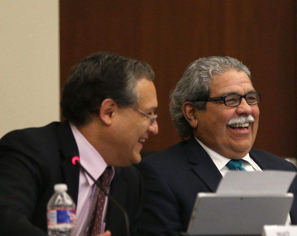 Board president Edwin Flores (left) and Superintendent Michael Hinojosa shared a laugh during a lighter moment at Thursday's Dallas school board meeting.