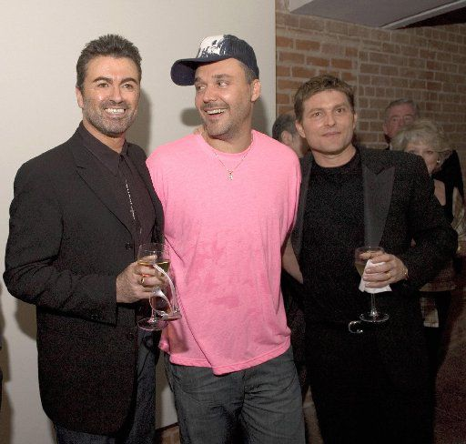 From left to right: George Michael, David LaChapelle and Kenny Goss at the Goss Gallery opening in Dallas in 2005.