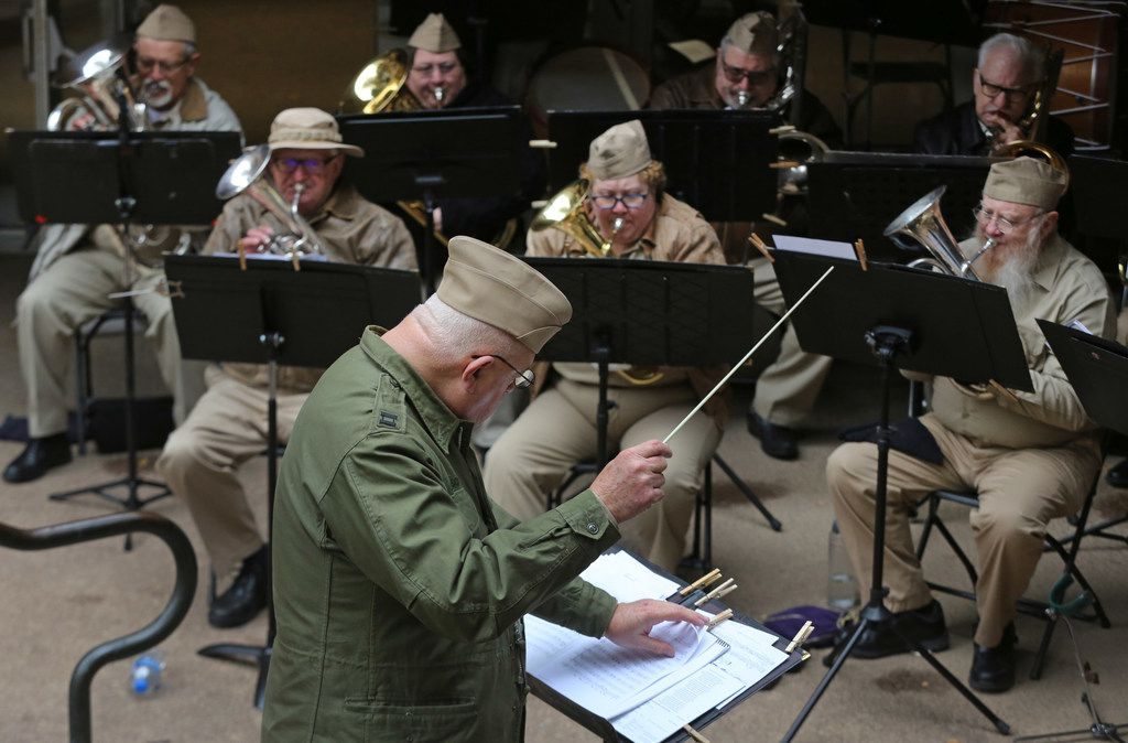 Larry Johnson directs the Heritage Brass Band as they play musical tributes during a Pearl Harbor remembrance held at Thanks-Giving Square in downtown Dallas, photographed on Thursday, December 7, 2017. (Louis DeLuca/The Dallas Morning News)