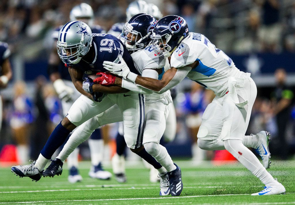 Dallas Cowboys wide receiver Amari Cooper (19) is tackled by Tennessee Titans cornerback Malcolm Butler (21) and free safety Kevin Byard (31) during the second quarter of an NFL game between the Dallas Cowboys and the Tennessee Titans on Monday, November 5, 2018 at AT&T Stadium in Arlington, Texas. (Ashley Landis/The Dallas Morning News)