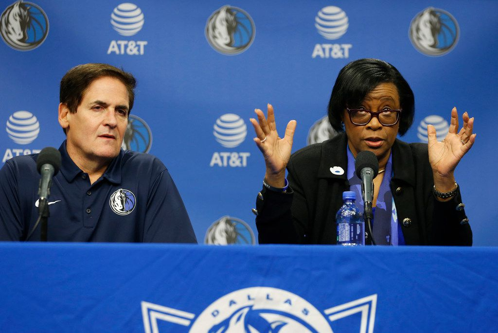 Dallas Mavericks interim CEO Cynthia Marshall answers questions from the media as Dallas Mavericks owner Mark Cuban listens during a press conference at American Airlines Center in Dallas on Monday, February 26, 2018. Marshall has been hired by the Mavericks to help clean up after the recent sexual harassment scandal in the front office. (Vernon Bryant/The Dallas Morning News)