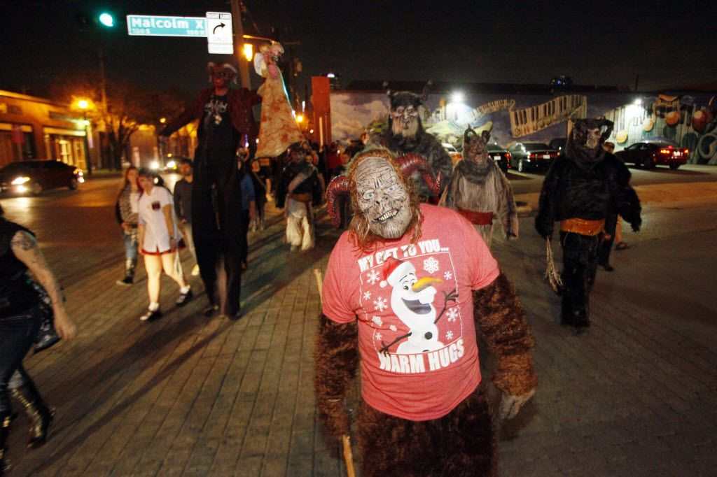 Krampus characters cross Malcom X Boulevard  during the Dallas Krampus Walk through the streets of Deep Ellum, organized by the Krampus Society and Dark Hour Haunted House, on Friday, Dec. 5, 2014.