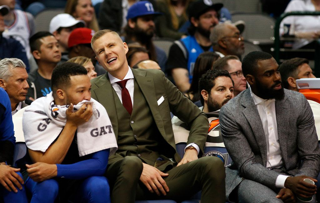 Dallas Mavericks forward Kristaps Porzingis (6) looks up as he sits in between Dallas Mavericks guard Jalen Brunson (13) (left) and Dallas Mavericks guard Tim Hardaway Jr. (11) (right) during the second half of play at the American Airlines Center in Dallas on Monday, April 1, 2019. Dallas Mavericks defeated the Philadelphia 76ers 122-102. (Vernon Bryant/The Dallas Morning News)