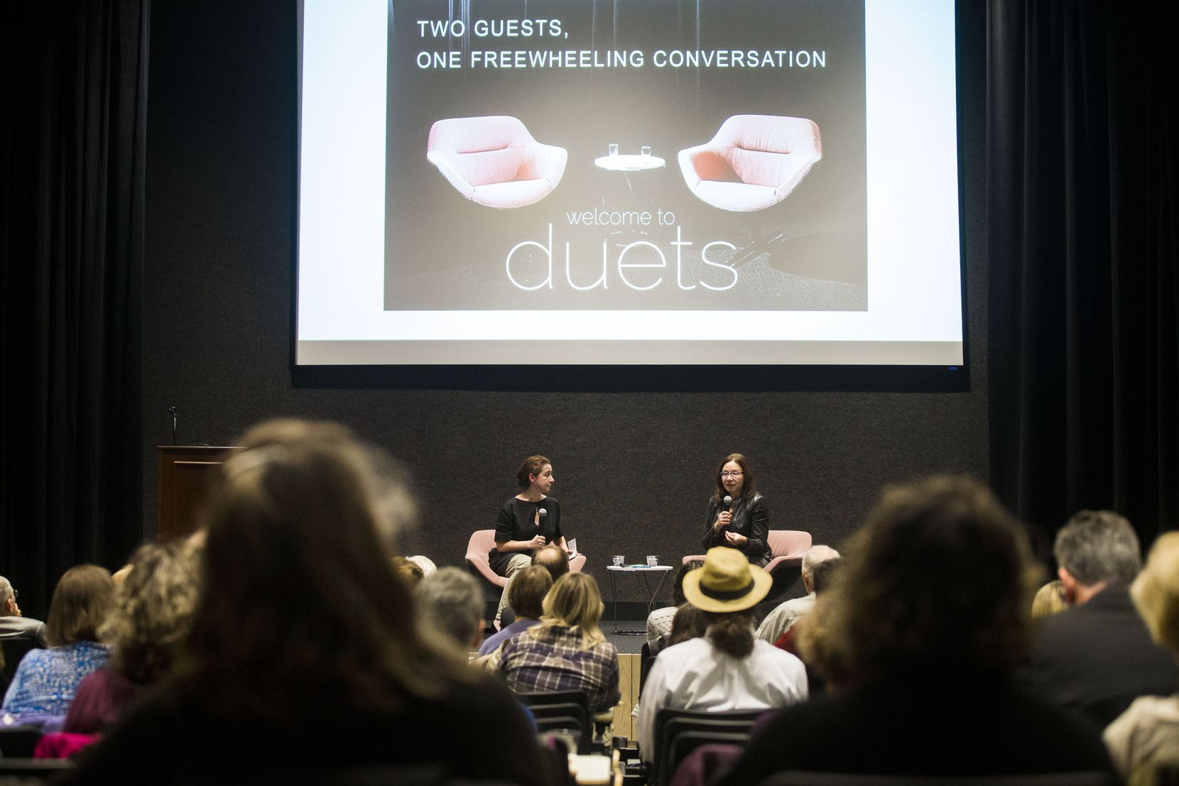 Anna Kuchment, science reporter at The Dallas Morning News, left, listens to Katharine Hayhoe, climate scientist at Texas Tech University talk during Duets Conversation Series at DMN in Dallas on Oct. 17, 2018. (Carly Geraci/The Dallas Morning News)