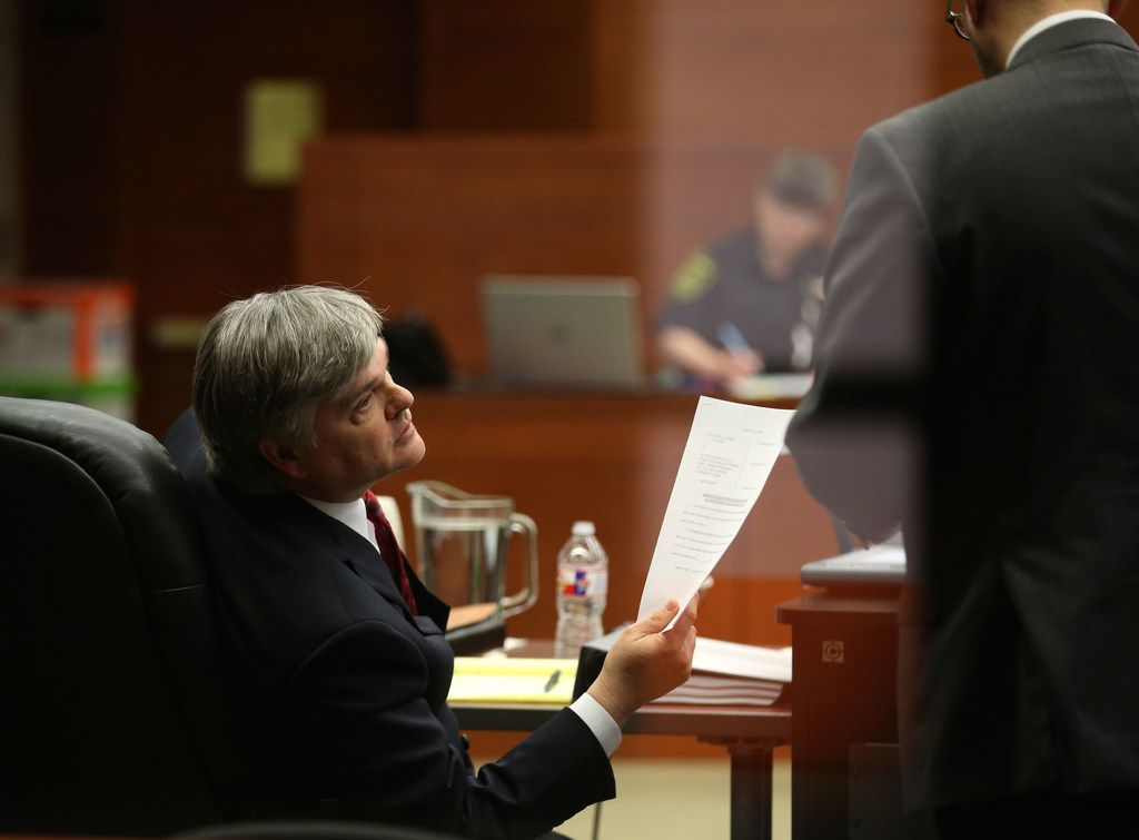 Scott Deatherage, left, attorney for Blue Star Recycling, holds a document alongside city attorney Andrew Gilbert during a hearing at Judge Gena Slaughter's courtroom at the George L. Allen Sr. Courts Building on Wednesday.