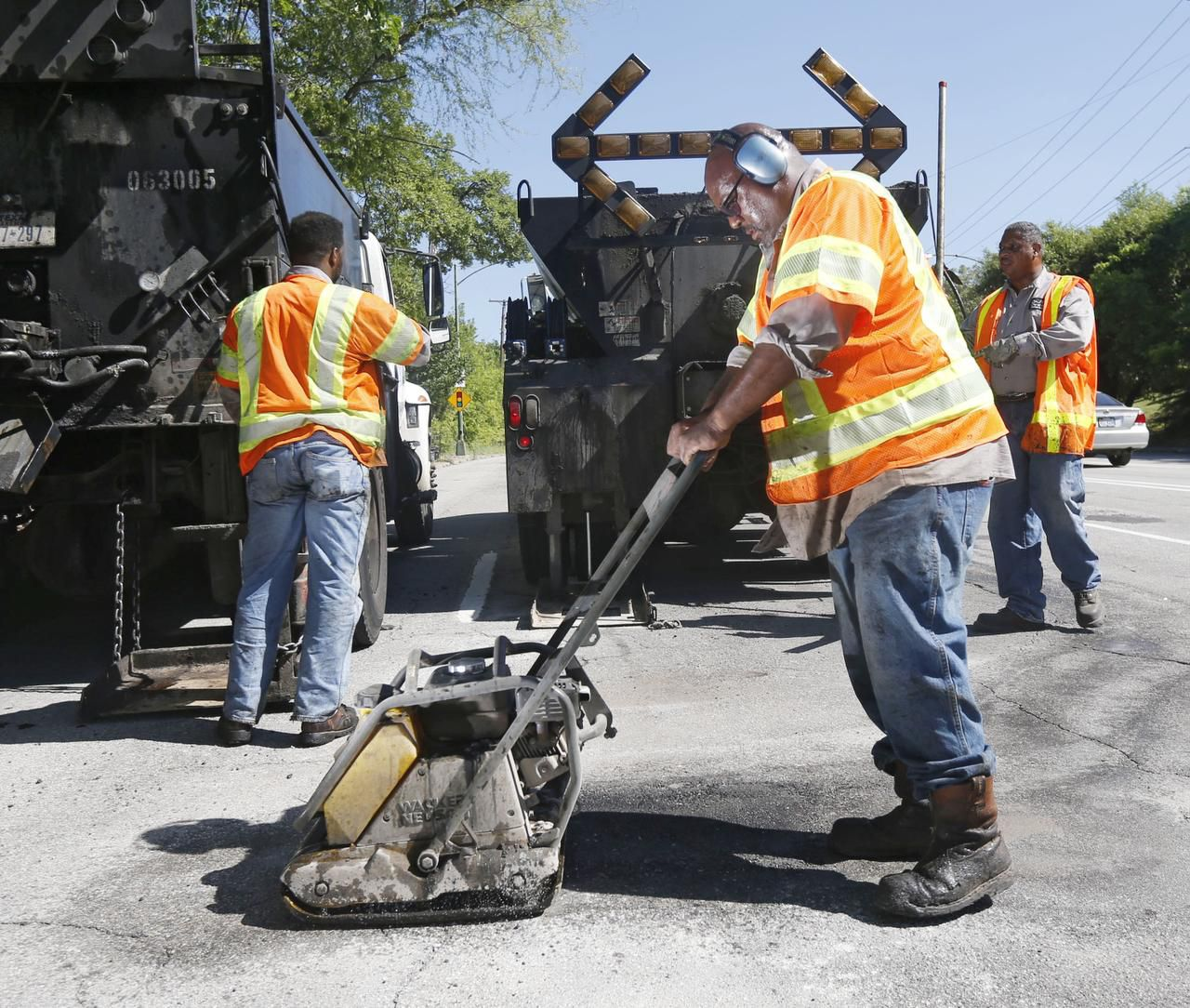 City employee Ricky King worked to patch a pothole Wednesday on Harry Hines Boulevard. The city says Dallas residents ranked streets as their No. 1 priority in a 2014 survey.