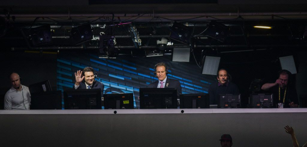 Broadcaster and former Dallas Cowboys quarterback Tony Romo, second from left, waves from the broadcast booth after an NFL game between the Dallas Cowboys and the Kansas City Chiefs on Sunday, November 5, 2017 at AT&T Stadium in Arlington, Texas. (Ashley Landis/The Dallas Morning News)