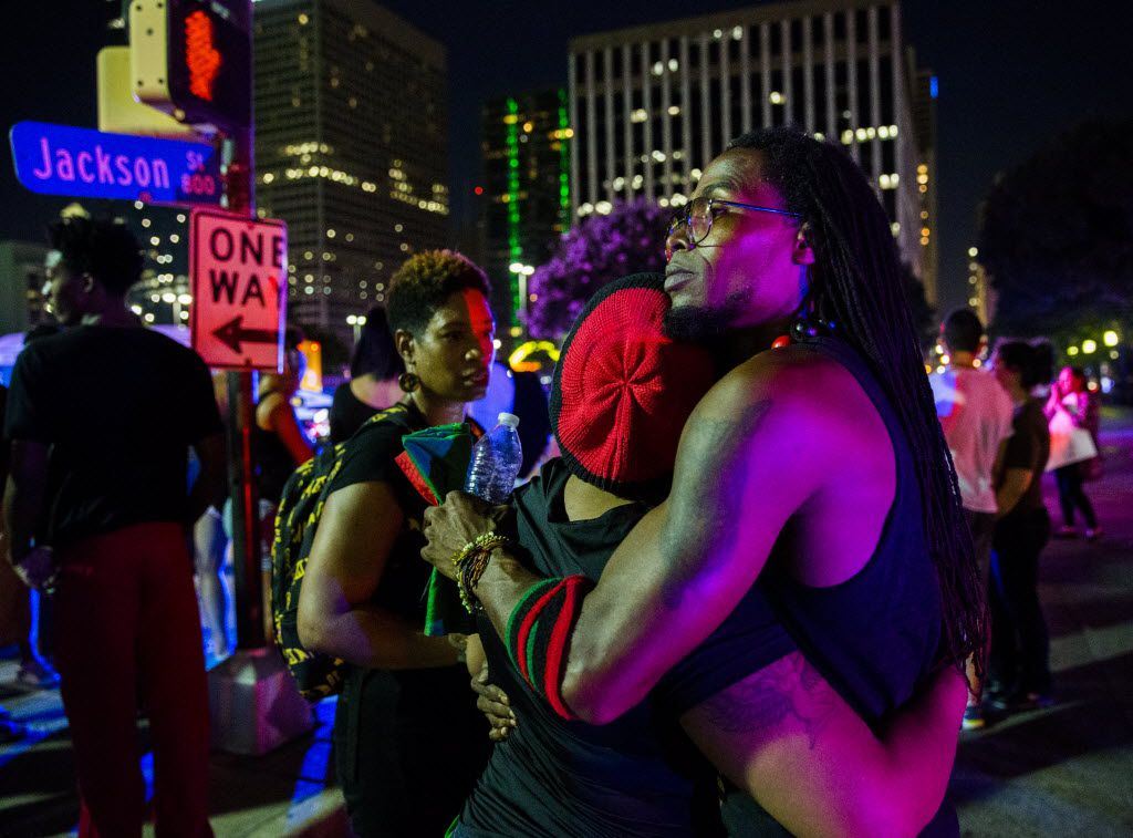 Protestors react after gunmen shot 11 people during a Black Lives Matter protest on Thursday, July 7, 2016 at the intersection of S Lamar and Jackson St in Dallas, Texas. Ashley Landis/Staff Photographer