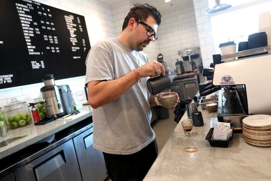 """One of the restaurants Yelp named as """"America's Top 100 Places to Eat in 2020"""" is the Aussie Grind, a coffee shop and breakfast spot in Frisco. Here, owner Lui Monforte pours a drink."""