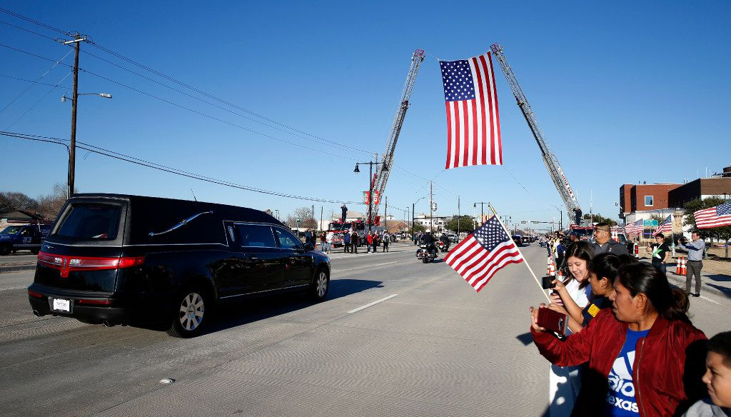 on the procession route on Eldorado Pkwy for Det. Jerry Walker killed in the line of duty in Little Elm, Texas on January 23, 2017. (Nathan Hunsinger/The Dallas Morning News)