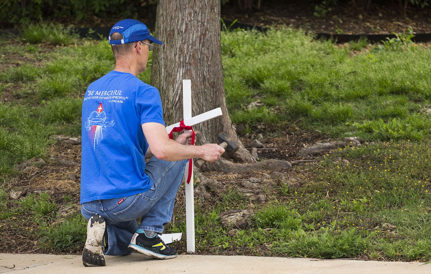 Tim Dougherty places crosses along Greenville Avenue before abortion opponents held a Good Friday vigil outside the Southwestern Women's Surgery Center on Friday, April 14, 2017, in Dallas.
