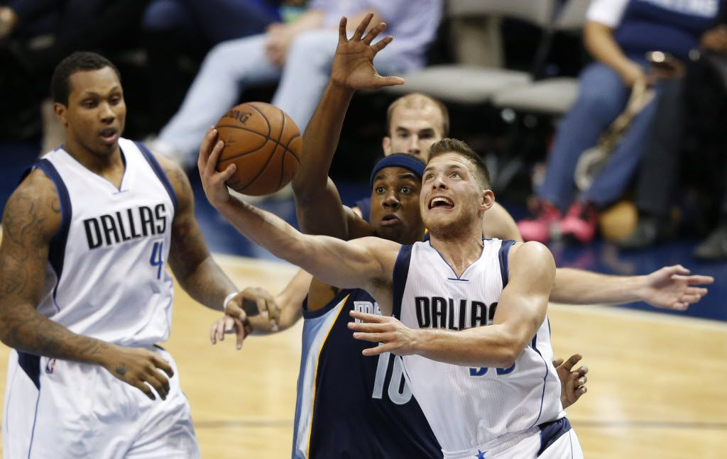 Dallas Mavericks guard Gal Mekel (33) attempts a shot in front of Memphis Grizzlies center Hassan Whiteside (10) during the second half of play in a preseason game at American Airlines Center in Dallas on Monday, October 20, 2014. Dallas Mavericks defeated the Memphis Grizzlies 108-103. (Vernon Bryant/The Dallas Morning News)