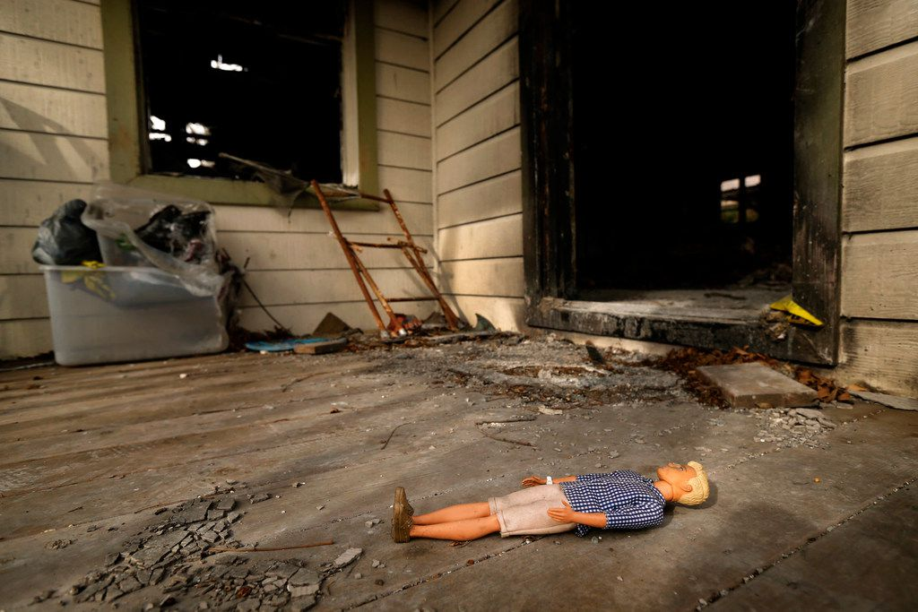 """A doll lies on the front porch of a Durango Drive house that burned in fire started by a natural gas leak, not far from site on Espanola Drive where Linda """"Michellita"""" Rogers died last year when a natural gas leak set off an explosion in her home."""