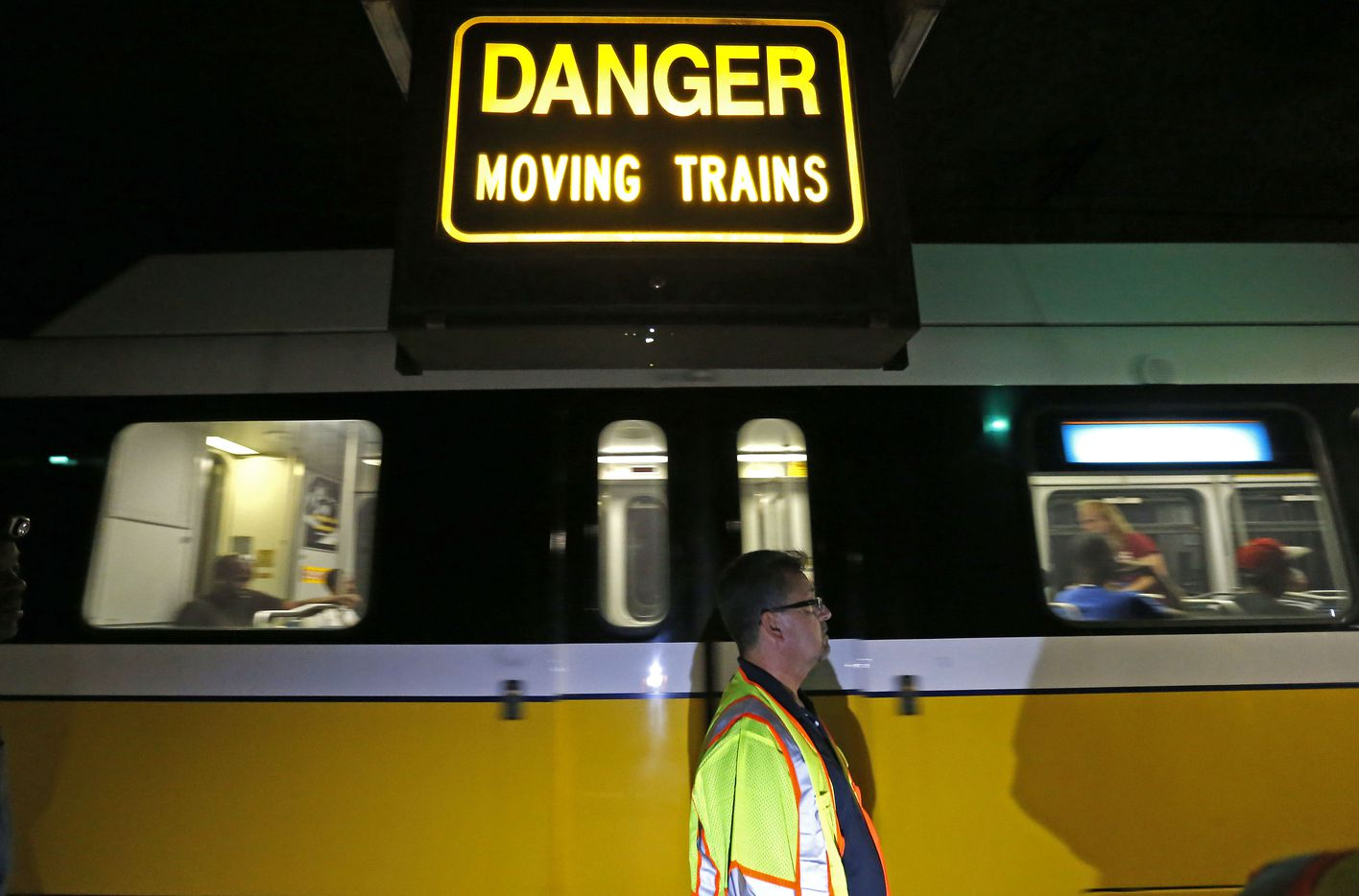 Javier Molina, DART's interim technical administrator, watches from a maintenance tunnel as a train passes. What was intended to be an underground station to serve the Knox-Henderson neighborhood now serves as access for workers and as an emergency exit route.