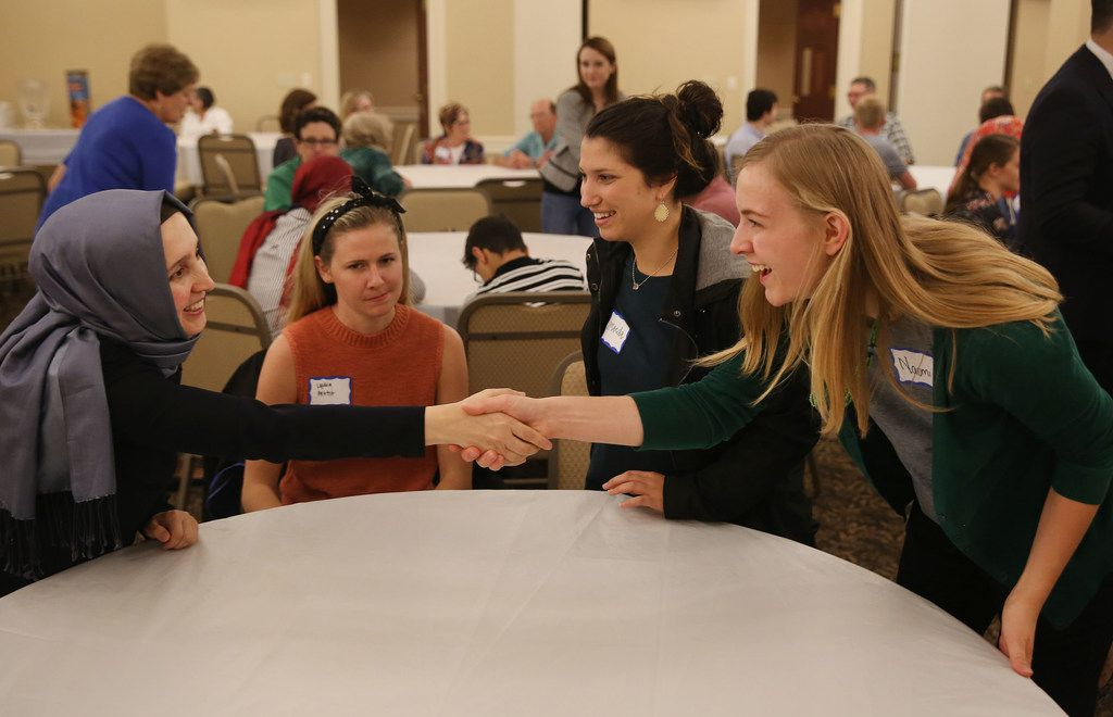 (From left) Nurcan Mete meets Lydia Pettit, Amanda Mintz and Naomi Mattay during an interfaith Ramadan dinner with members of the Dialogue Institute and Wilshire Baptist Church at the church in Dallas Thursday June 7, 2018. Guests broke the Ramadan fast after Emrah Aktepe, who is director of the Dialogue Institute Dallas, explained Ramadan.
