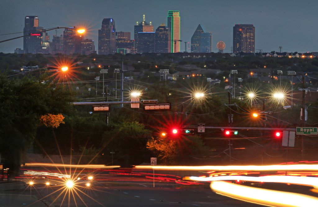 Traffic zips by a view of the Dallas skyline from north of Royal Lane and Abrams Road in Lake Highlands.