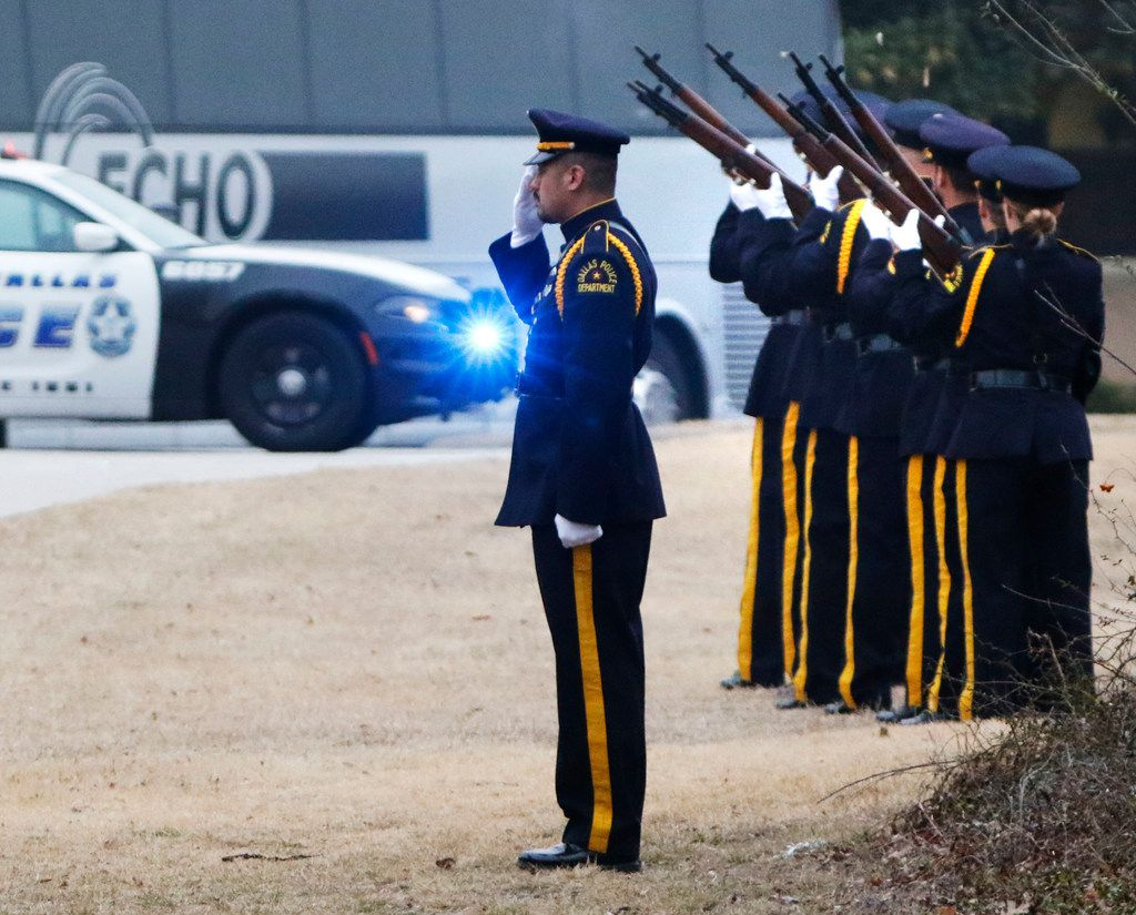 Dallas police officers fired a 21-gun salute for Richardson police Officer David Sherrard outside Watermark Community Church in Dallas on Feb. 13. (David Woo/The Dallas Morning News)