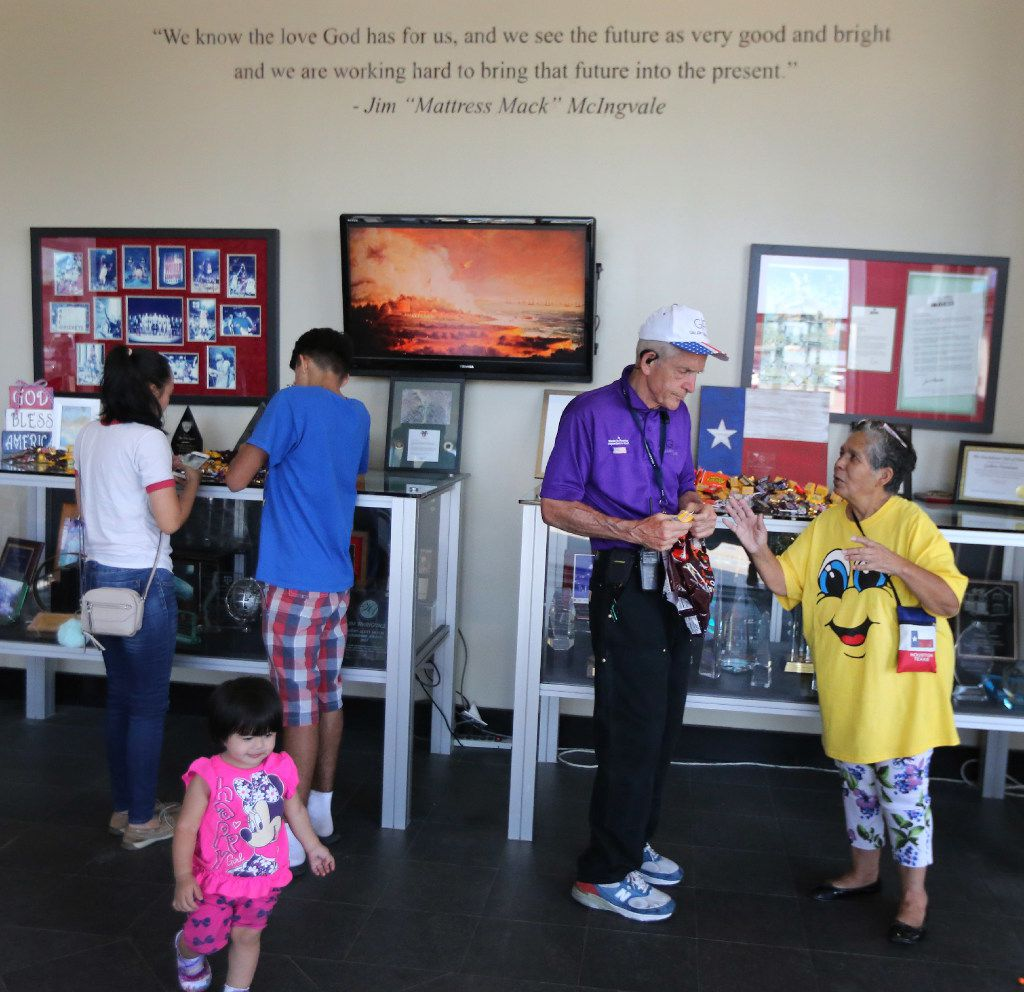 """Jim """"Mattress Mack"""" McIngvale, locally famous for philanthropy and his commercials for his business, Gallery Furniture, takes time to talk with customers as he puts out candy for them on counters and displays at the store in north Houston on Sept. 11, 2017."""