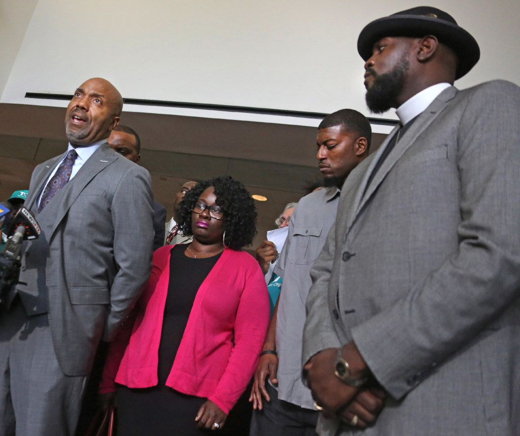 Attorney Daryl Washington talks with the media as Jordan Edwards' stepmother Charmaine Edwards and father Odell Edwards listen at a May 11 press conference. At right is Pastor Michael Waters.