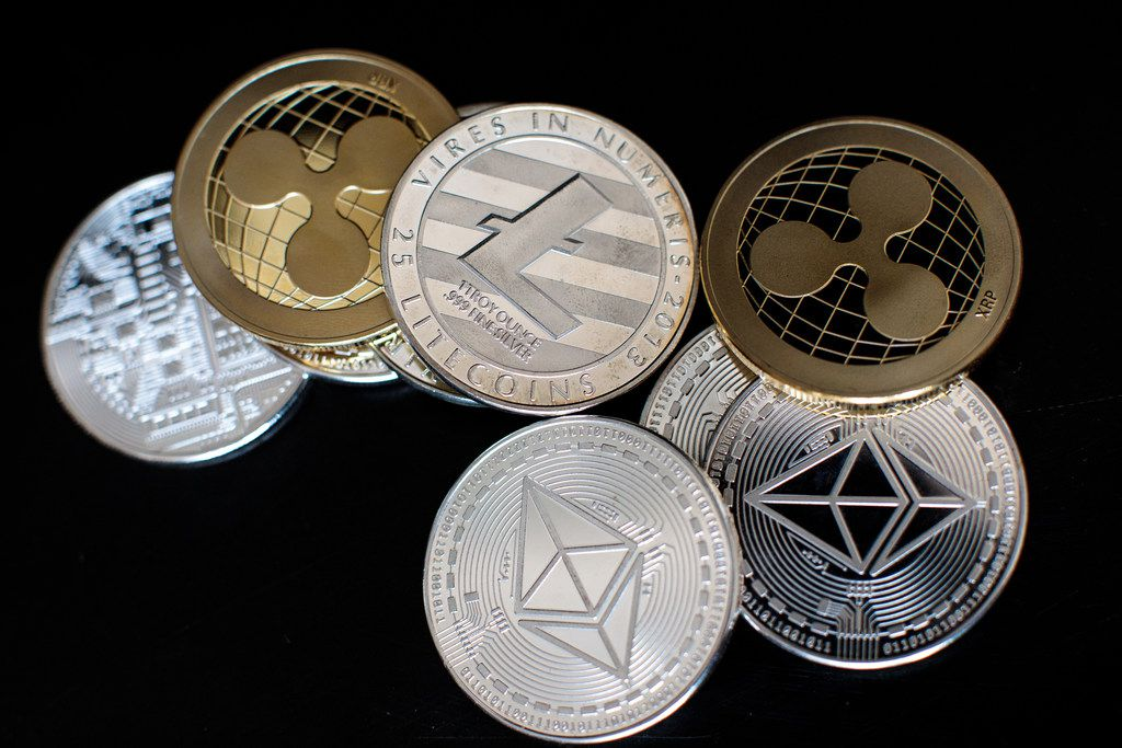 Illustration of llitecoin, ripple and ethereum cryptocurrency 'altcoins.'