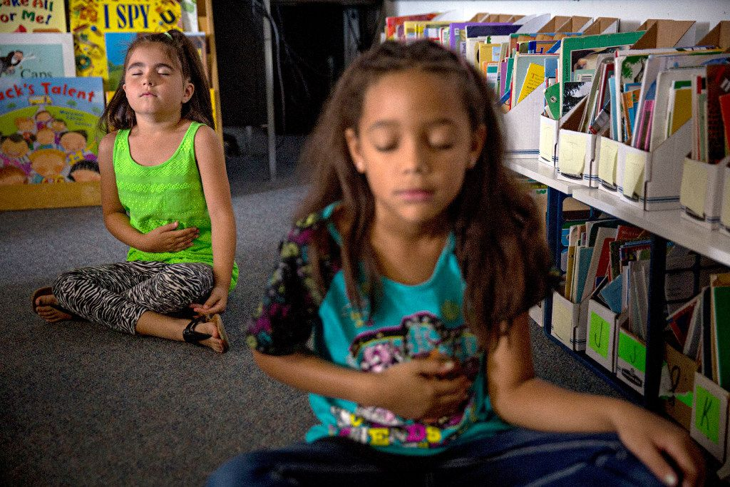 Felicity Veliz (left) and Kalyssa Flynn work on breathing techniques during a mindfulness period at Davis Elementary Monday, September 19, 2016 in Carrollton, Texas. Students at the school take part in a variety of activities aimed at helping keep them calm and focused both in the classroom and at home.