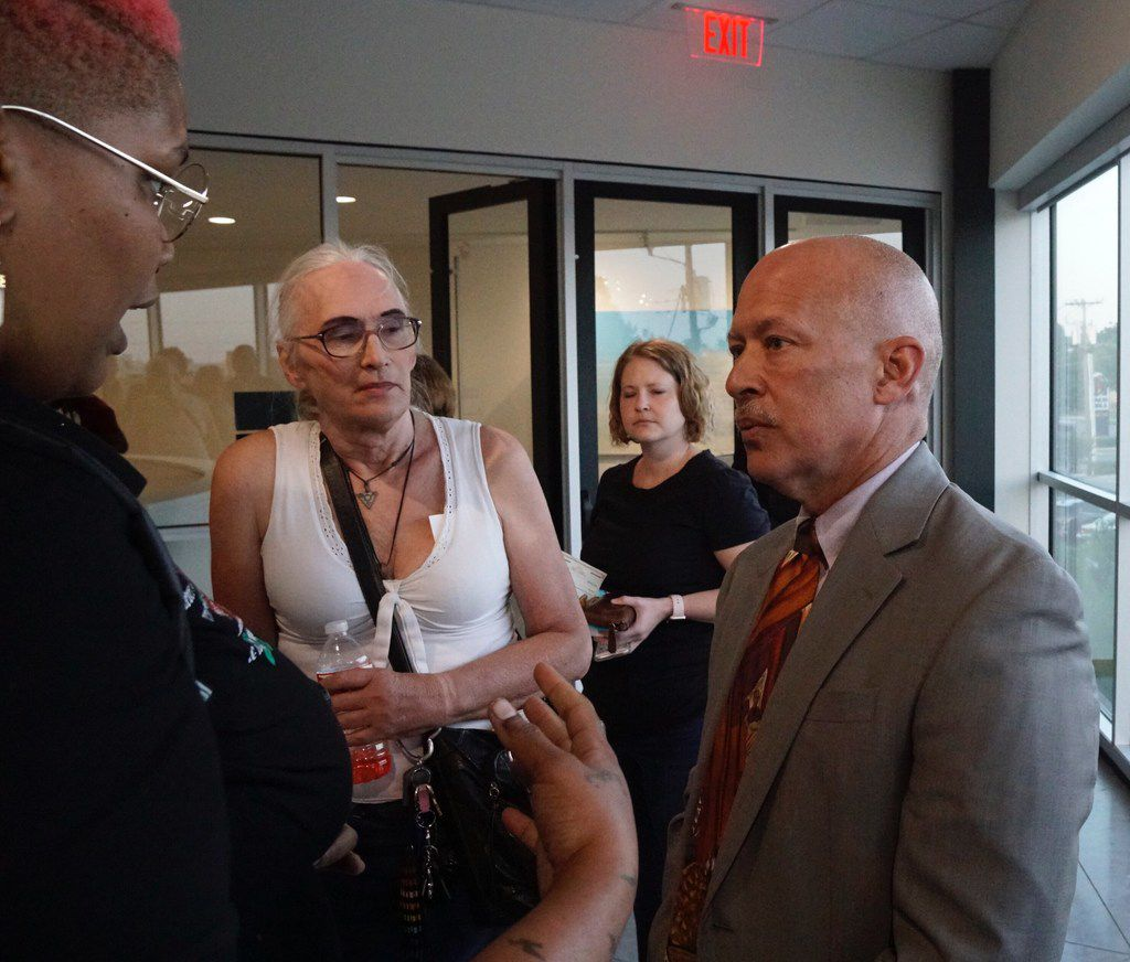 Niecee X, left, and Pamela Curry speak with District Attorney John Creuzot during a town hall meeting for the LGBTQ community at The Resource Center in Dallas, TX on Thursday May 23, 2019. The meeting was hosted by the Dallas Police Department. (Lawrence Jenkins/Special Contributor)