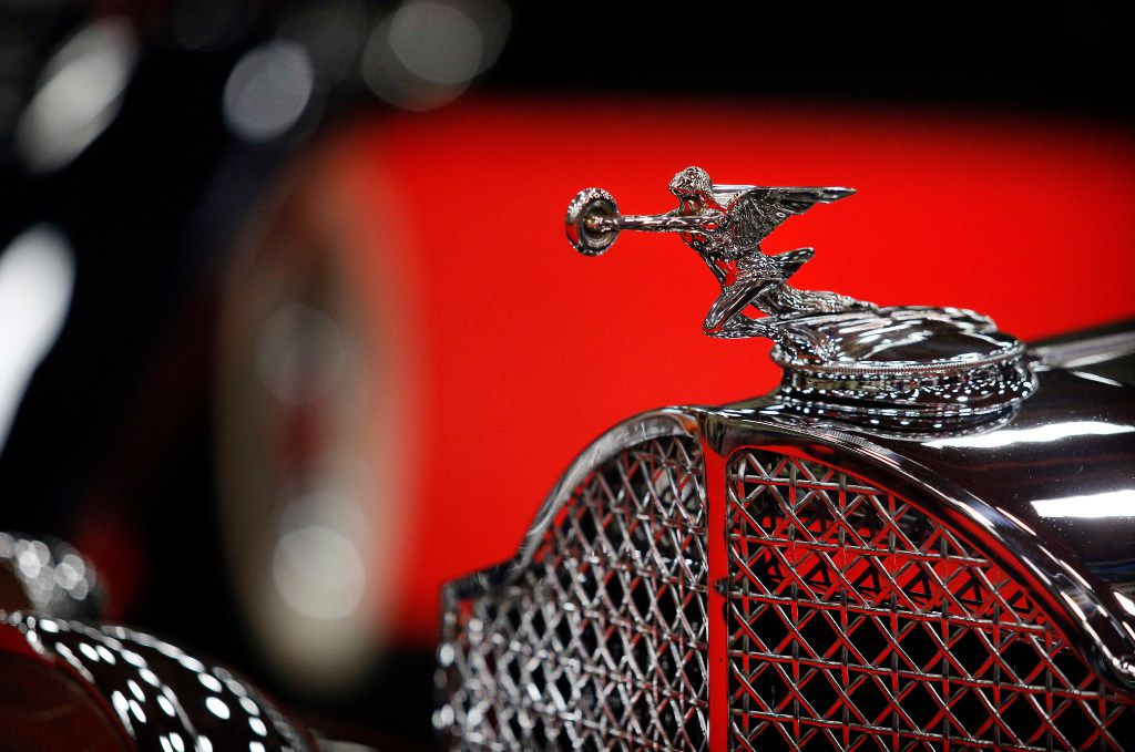 The red carpet is reflected in the hood ornament and grill to a 1932 Packard Eight 902 Coupe during the Mecum Auctions collector car auction at the Kay Bailey Hutchison Convention Center in Dallas, Friday, September 8, 2017. About 900 cars are on display for the four-day event. The event that is open to the public is the third largest on tour. The auction continues on Saturday. (Tom Fox/The Dallas Morning News)