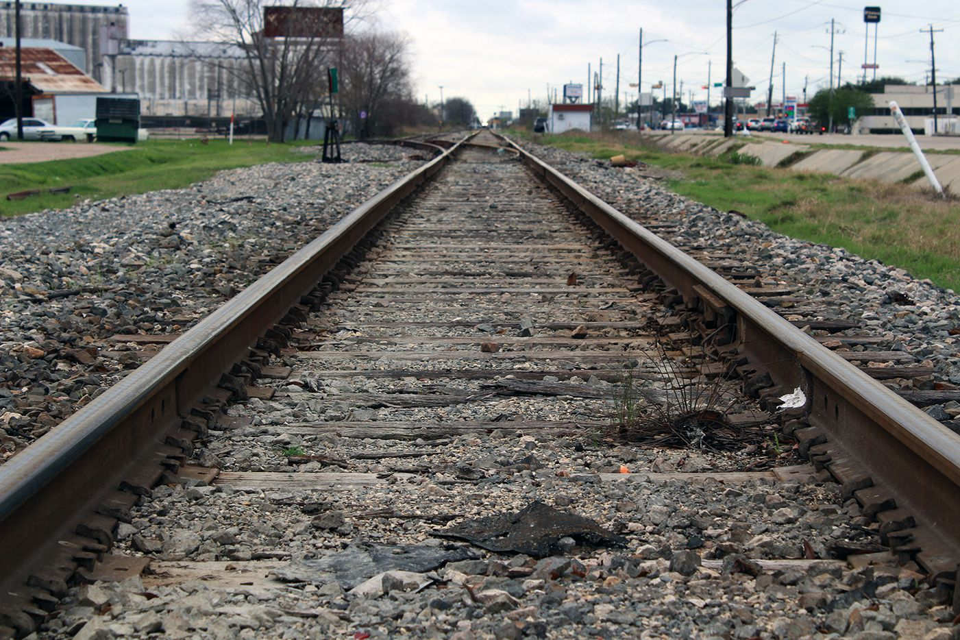 As it approaches its potential Houston station near Interstates 10 and 610, a planned bullet train connecting the city to Dallas could run on Hempstead Road parallel to this existing rail line near Northwest Mall.
