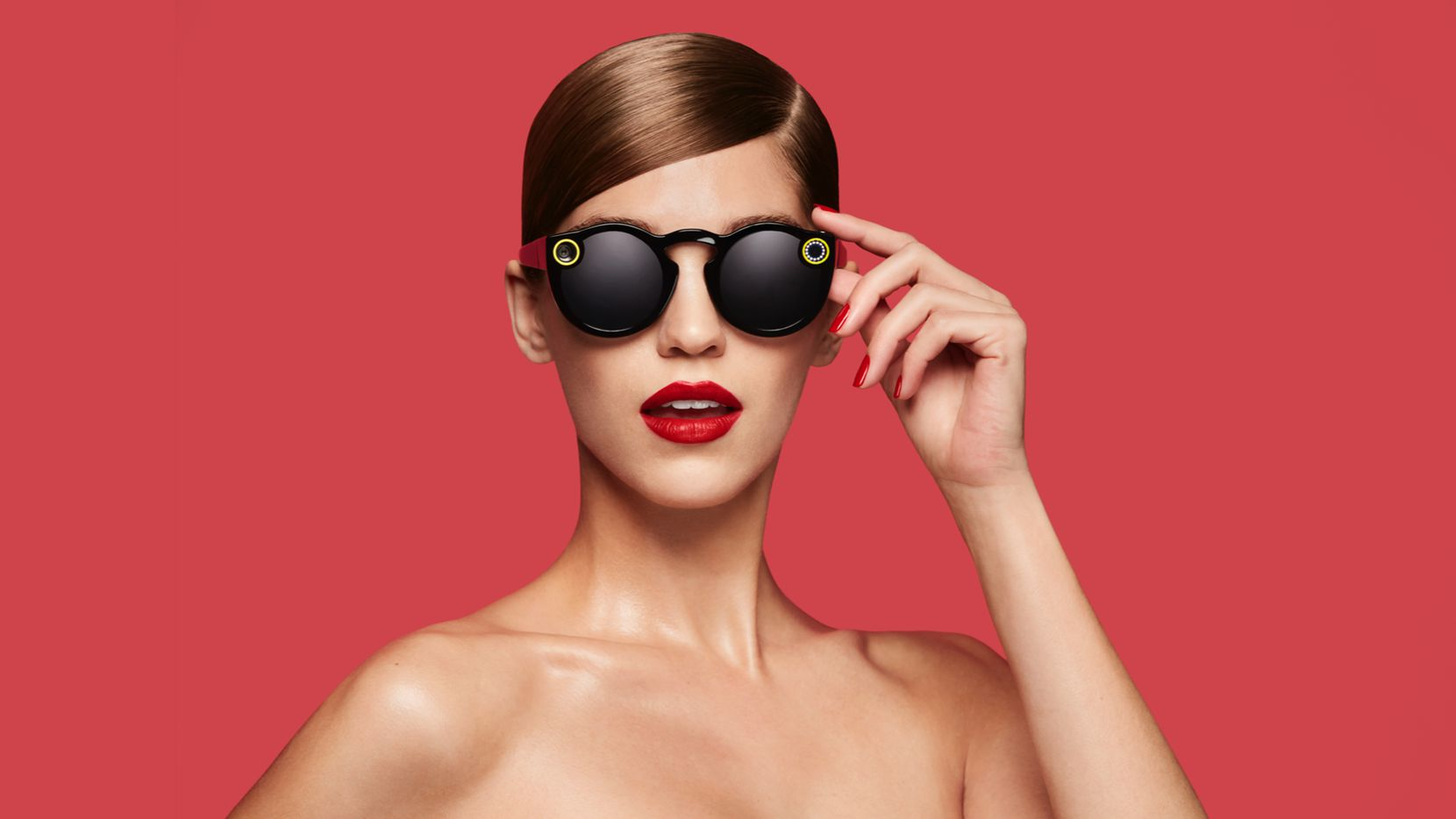 """This undated image courtesy of Snap Inc. shows the company's Spectacles video-catching sunglasses. Snapchat announced on September 24, 2016, it will launch a line of sunglasses, a spin on Glass eyewear abandoned by Google more than a year ago. The California-based company said in an online post that its Spectacles will be """"available soon,"""" with media reports pegging the price at $130 a pair."""