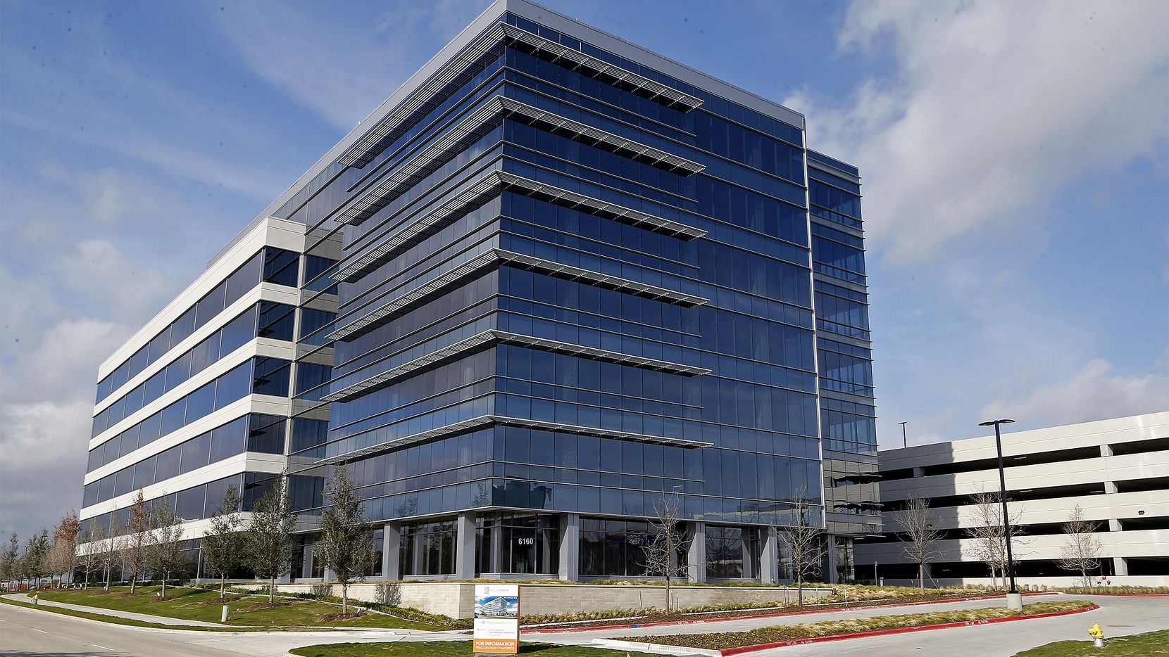 The first seven-story office building in Frisco Station has opened its doors just over a year after the groundbreaking.