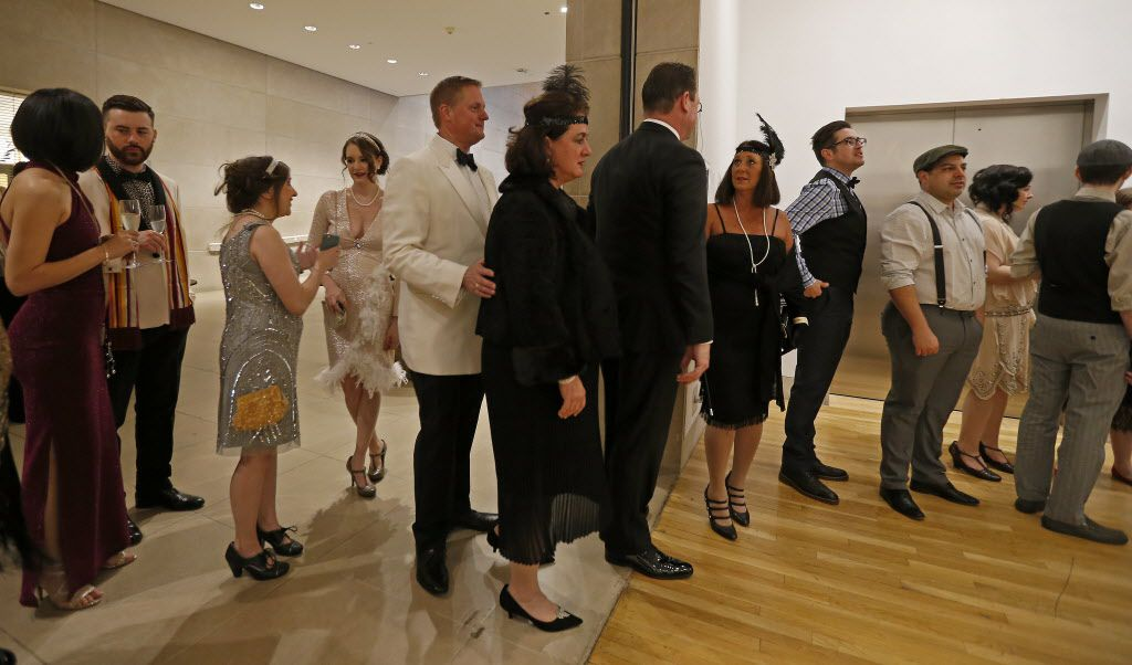 Guests stay in line to have their pictures taken at the photo booth during the DMA Speakeasy event in celebration of Shaken Stirred Styled: The Art of the Cocktail at Dallas Museum of Art in Dallas, Saturday, Feb. 4, 2017.