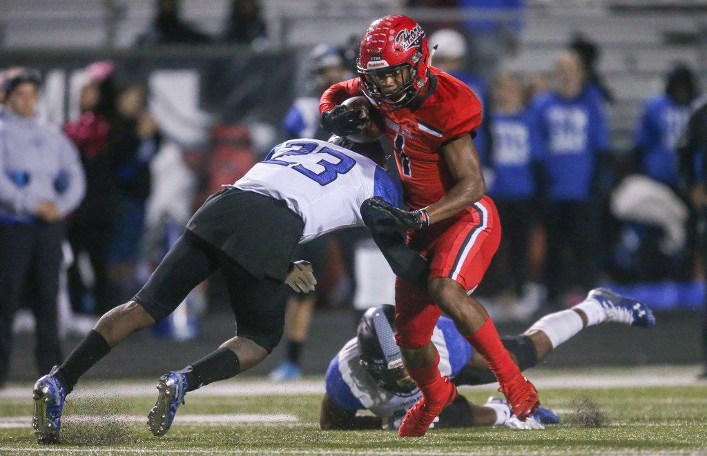 Cedar Hill wide receiver Quin Bright (1) carries the ball past Mansfield Summit player Ahmaad Moses (23) during the first half of a high school football game between Cedar HIll and Mansfield Summit on Friday, October 11, 2019 at Longhorn Stadium in Cedar Hill, Texas. (Shaban Athuman/Staff Photographer)