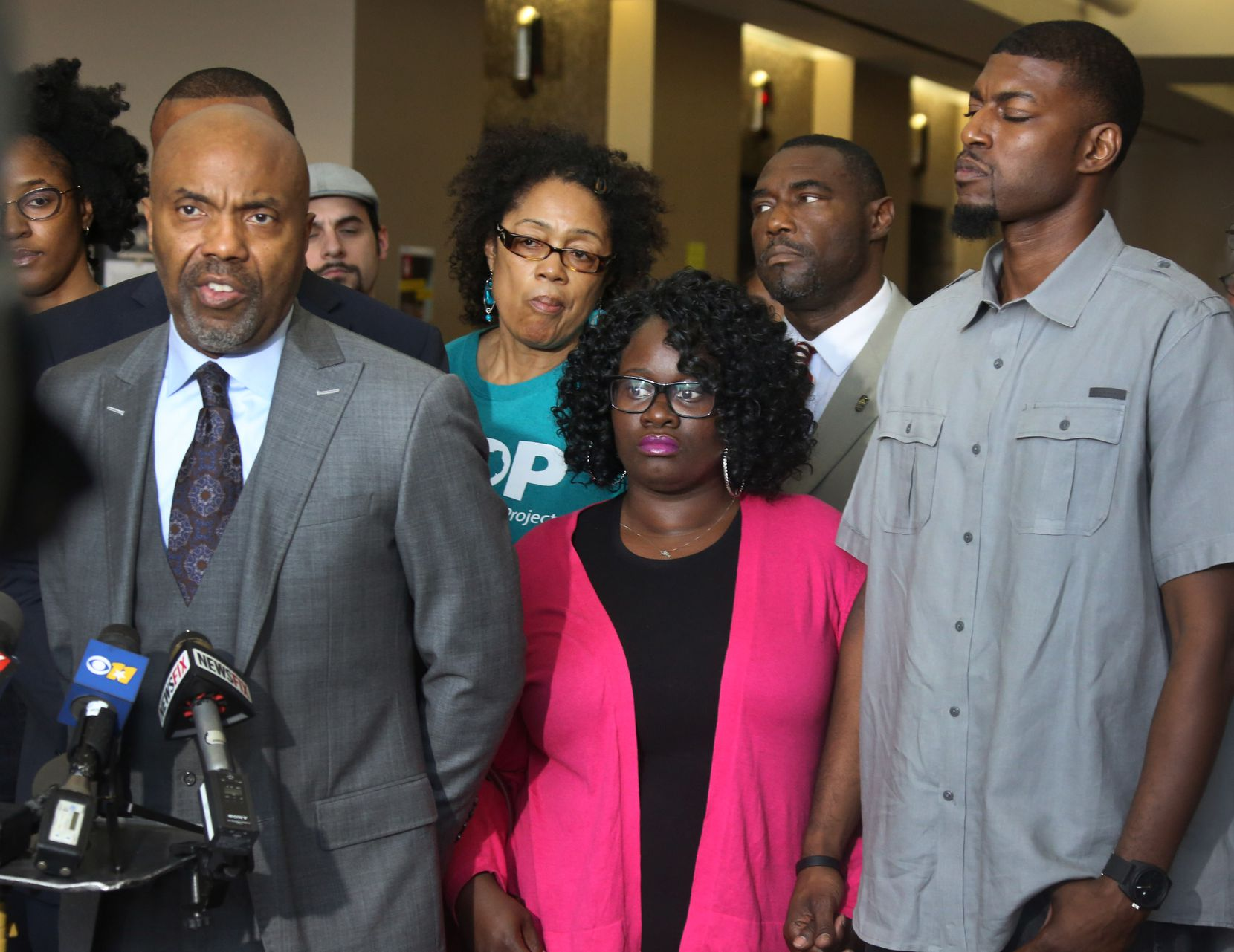 In this May 11, 2017 photo, Attorney Daryl Washington talks with the media as Jordan Edwards' step-mother Charmaine Edwards and father Odell Edwards, center and right, listen at a press conference. Edwards' killing garnered national attention.