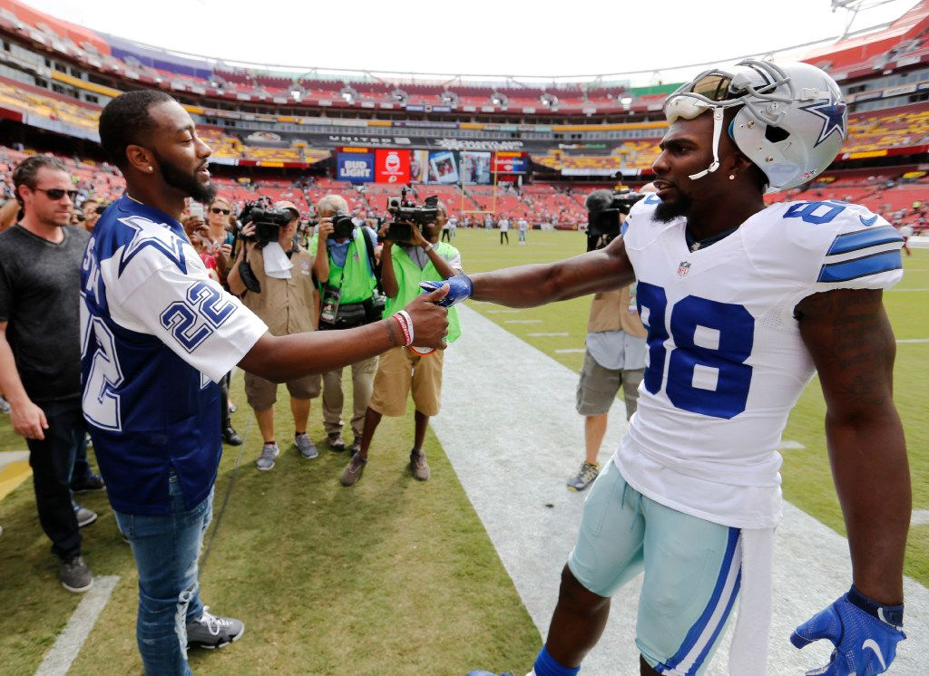 Cowboys wide receiver Dez Bryant (88) greets Washington Wizards player John Wall bin Landover, Md. on , Sept. 18, 2016. (Vernon Bryant/The Dallas Morning News)