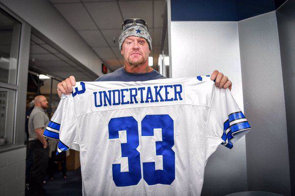 The Undertaker shows off his Cowboys jersey