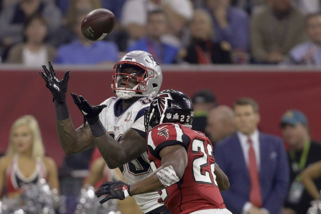 New England Patriots' Martellus Bennett eyes the ball under pressure from Atlanta Falcons' Keanu Neal, during the second half of the NFL Super Bowl 51 football game Sunday, Feb. 5, 2017, in Houston. (AP Photo/Darron Cummings)