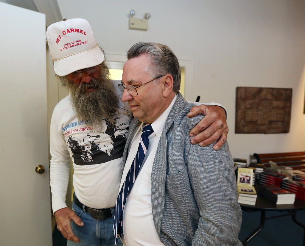 Branch Davidian Clive Doyle, right, gets a hug from longtime friend Rick Donaldson, left, during a memorial service on April, 19, 2013, in Waco.