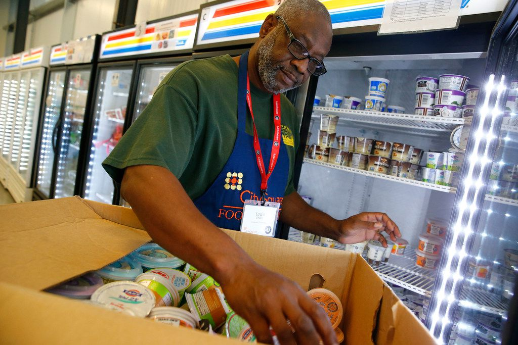 Volunteer Louis Lewis organizes yogurt at CitySquare Opportunity Center food pantry in Dallas. Reba McEntire will perform at a fundraiser for the group Sept. 15.