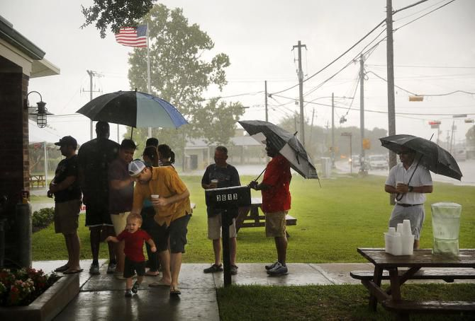 Customers who didn't show up early enough endured squalls of rain while waiting outside Killen's BBQ in Pearland.