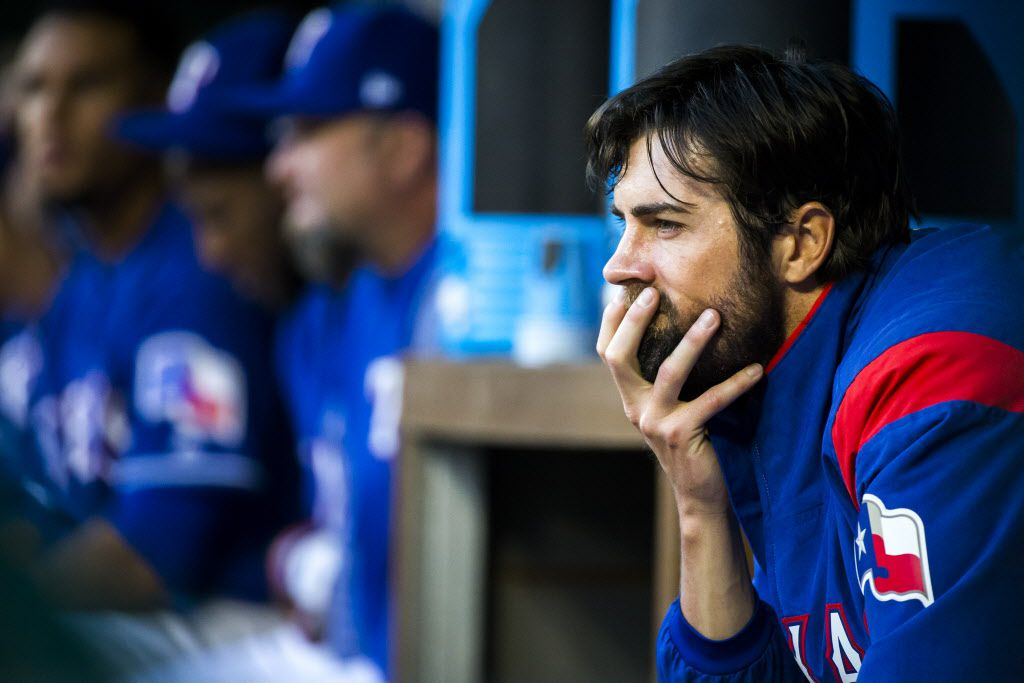 Texas Rangers starting pitcher Cole Hamels watches from the dugout during the second inning against the Minnesota Twins at Globe Life Park on Wednesday, April 26, 2017, in Arlington. (Smiley N. Pool/The Dallas Morning News)