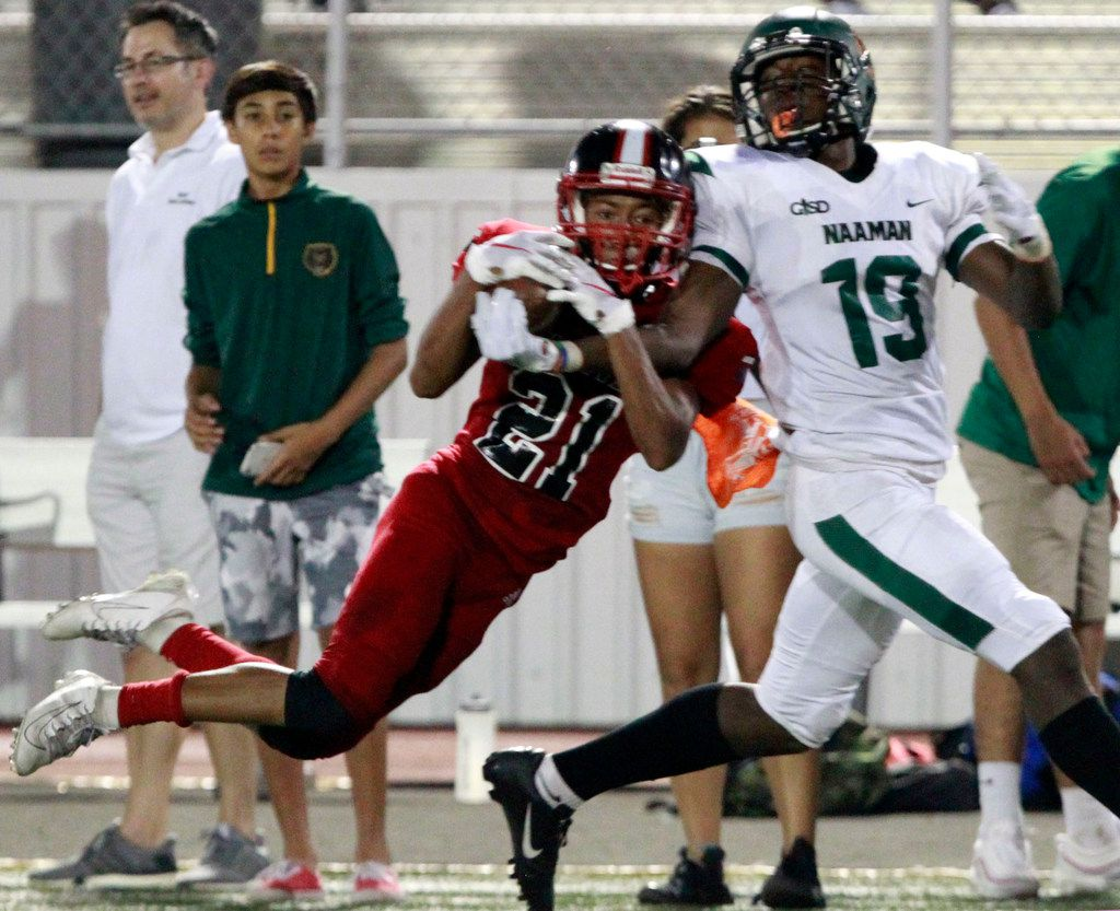 North Garland defender Isaiah Watkins (21) makes an interception in front of Naaman Forest's Bryson Huey (19) during the first half of their high school football game at Williams Stadium in Garland on Friday, October 4, 2019. (John F. Rhodes / Special Contributor)