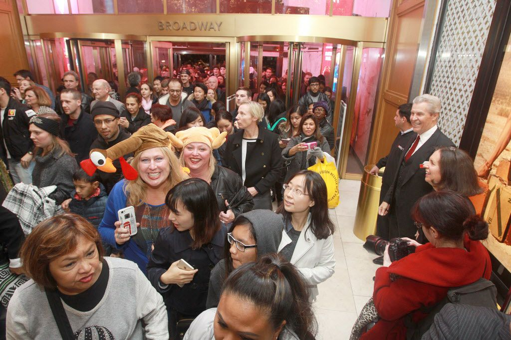 """IMAGE DISTRIBUTED FOR MACY'S - Eager shoppers pour into the Macy's Herald Square flagship store upon store opening for """"Black Friday"""" 2015 on Thursday, Nov. 26, 2015 in New York."""