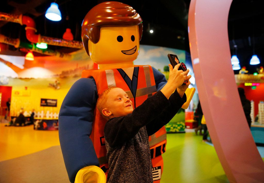 Zachary Peltonen, 7 of McKinney takes a selfie with Emmet at Legoland Discovery Center at Grapevine Mills in Grapevine.
